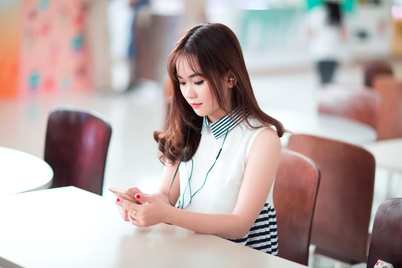 Dependent Prepositions - Chinese Girl with smartphone
